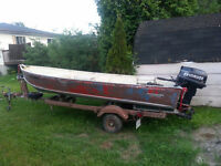 Aluminum Boat with 25 HP Evinrude and tilt trailer
