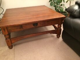 """Coffee table with """" distressed"""" wood finish."""