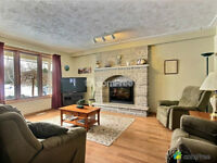 Custom built home on 1 acre lot backing onto the river in Salem