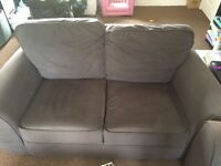 Grey two and three seater settee.