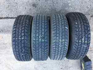 "Winter tires and rims 215/70R15 with 5x114.3 15"" steel rims"