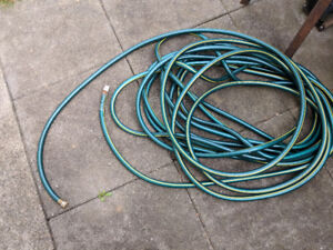 """100 ft 5/8"""" hose and free standing hose reel"""