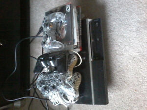 PlayStation 3 with 5 controllers and 4 games