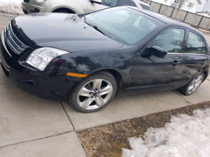 Ford Fusion- 2 sets of tires & command start