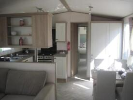 For sale new luxury static caravan holiday home sited South Devon beach pool bar