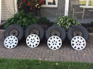 4 Bridgestone Blizzak WS70 235/65R16 winter tires on steel rims