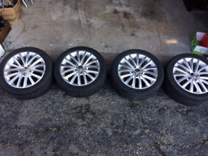 225 45 17 Goodyear eagle all seasons on rims set of 4