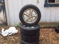 4 winter tires on mag wheels 16 inch