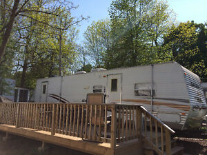 30' Selem Trailer on lot with deck