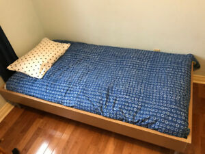 Single IKEA bed great for kids, students or extra company