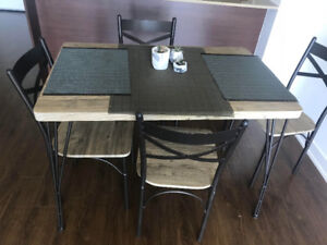 Modern dining table with four chairs (almost new) - 200$