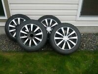 Four 205/55R16 Winter tires on Multi Fit Mags
