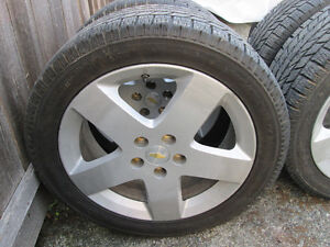 4    As new Toyo Snow tires on 2006 Chev HHR Mags c/w lug nuts