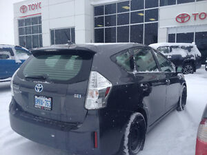 2012 Toyota Prius V (Hybrid) Hatchback, includes 4 studded tires