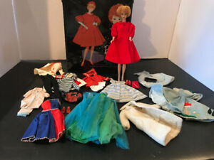 Vintage Barbie blonde bubble cut with clothes and case