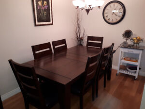 Ashley dining table and six chairs