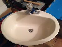 Bathroom sink with tap and hardware