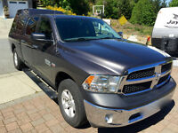 Dodge 2014 Ram 1500 SLT with hitch (2015) and truck cap (2014)