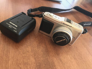 Olympus EP-1 with 17mm lens.  Like New