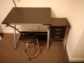 Adjustable drafting desk