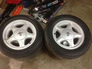 For sale, mustang pony wheels in good shape with drag radials