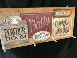 old fashioned bathroom sign with hooks