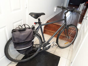 Miele hybrid commuter bike with seat suspension, rack, panniers