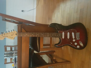 Left handed Fender Squire Stratocaster and Fender champion amp.