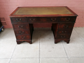 A Twin Pedestal Green Leather Inlay Desk