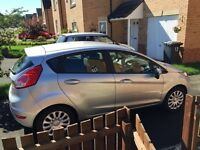 Silver Ford Fiesta 2014 plate