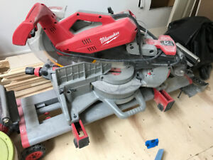 "Milwaukee 12"" Mitre saw with rolling stand Great condition"
