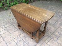 Oak expandable cabinet table