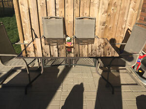 Patio glass table with 4 metal chairs