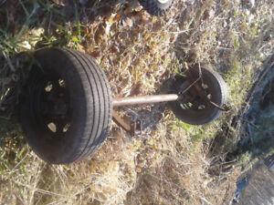 Trailer axle with tires and rims