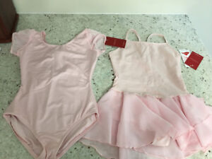 New with tags...Set of 2 Girls pink ballet body suits size 6/7