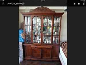 solid wood display cabinet and dining room table with chairs