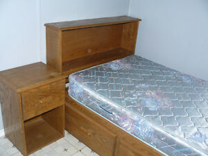 Oak wood Captains Bed, headboard, nightstand and desk.