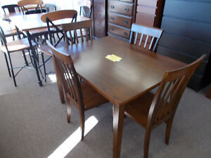 Large selection of table and chair sets. $399. and up.