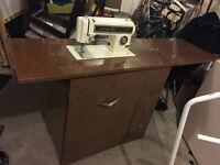 Sewing machine with table- in good condition-85$