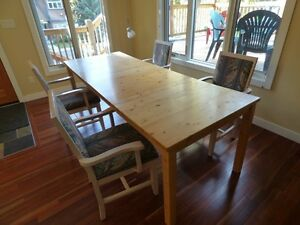 well maintained wood table with 4 chairs