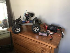 Stampede 4x4 radio controlled car, charger, and accessories