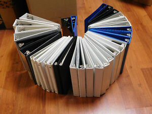 GENTLY USED 3 RING BINDERS AND DUDTANGS