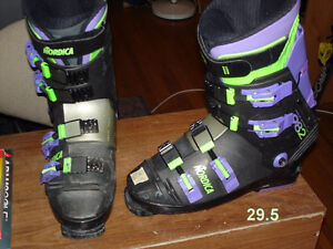 Ski boots, ski poles and goggles