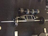 100 kg of weights plus bars