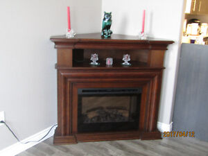 SOLD....SOLD....SOLD  LIKE NEW CORNER FIREPLACE WITH REMOTE