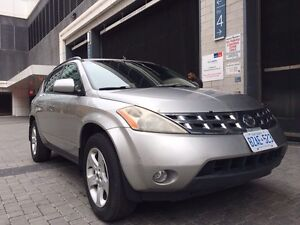 Silver Nissan Murano with full emission