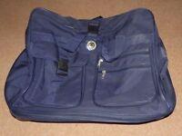 Large Blue Rolling Wheeled Expanding Luggage Duffel Bag
