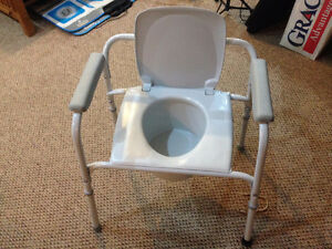 TOILET CHAIR, commode chair. Invacare. toilet seat chair