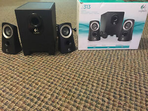Almost new Logitech stereo speakers and subwoofer