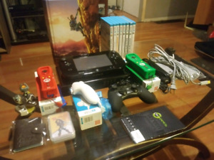 Nintendo Wii U with 8 games and accessories